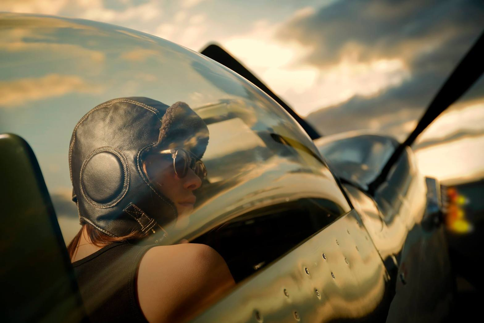 Beautiful female pilot in a war plane