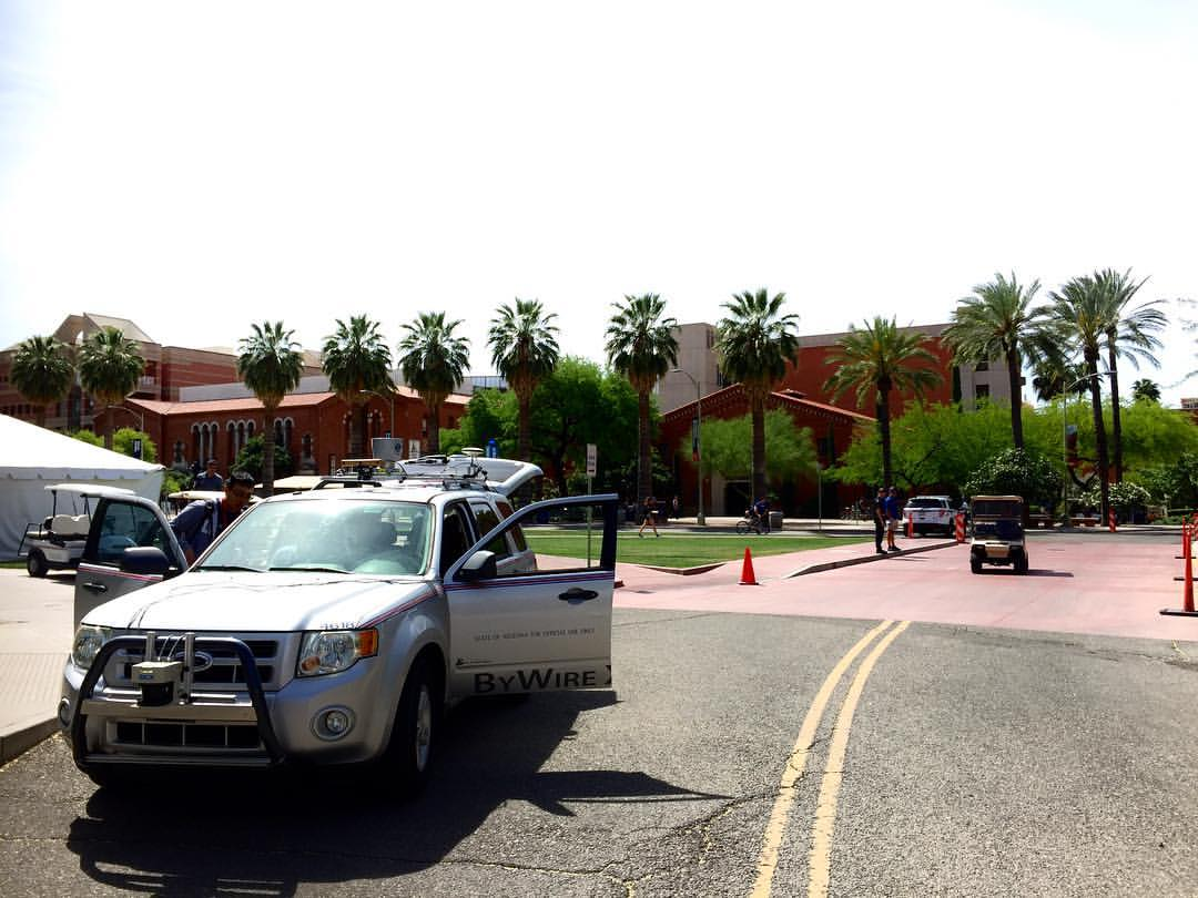 The self-driving CAT Vehicle sits at the University of Arizona Old Main's east side.