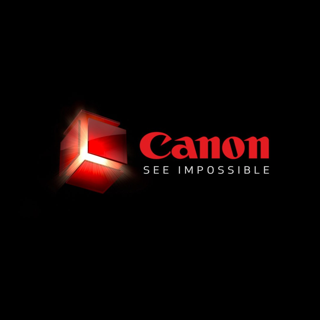 "Canon Logo - black background, red Canon 3-D logo, red letters spelling Canon, white letters spelling ""See Impossible"""